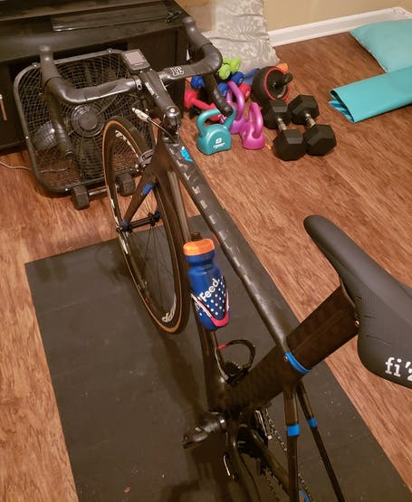 An example of a stationary bicycle with a fan placed in front of it.
