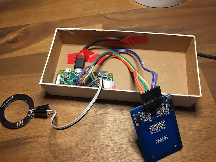 Step 1: Put the Pi on the bottom left side of the box and fix the cable with two tape stripes.