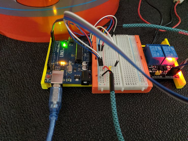 Arduino Uno connected to 2 proximity sensors and 2 relays