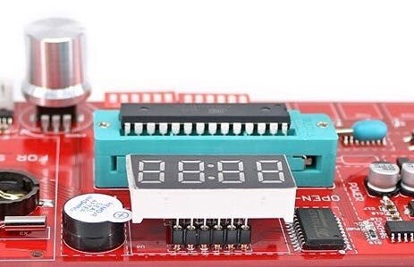 The buzzer is positioned next to the 7-segments display. Remove its cover to use it.