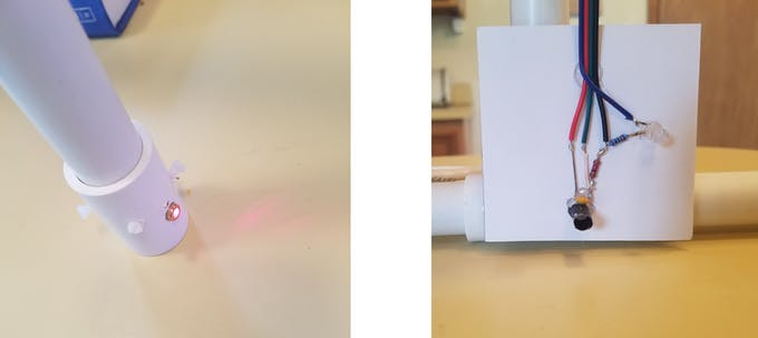 The center base of each photogate arch has 2 lasers (left photo) pointing to the phototransistor (right).