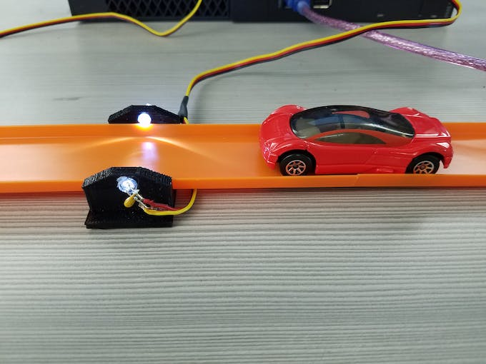 A single photogate only measures relative speed for an individual car