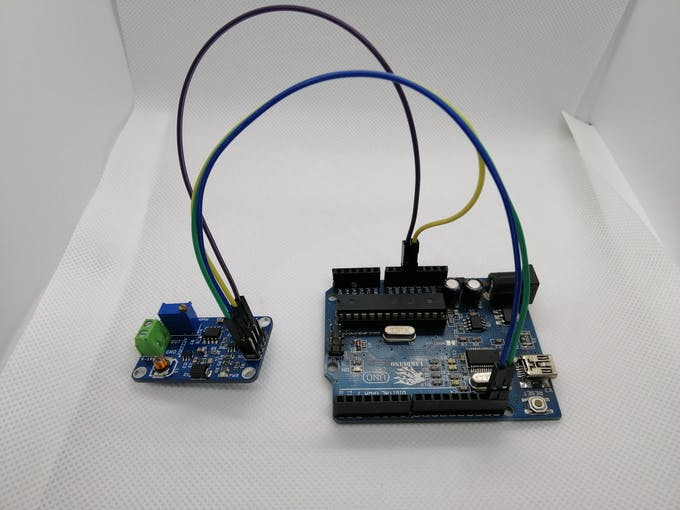 Module connected with jumper wires to an arduino uno