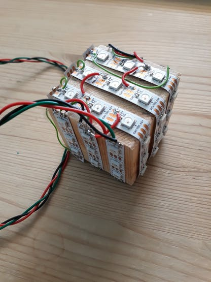 Wooden block wrapped in LED strips