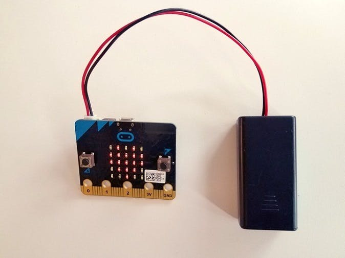 Connect it to micro:bit power supply connector