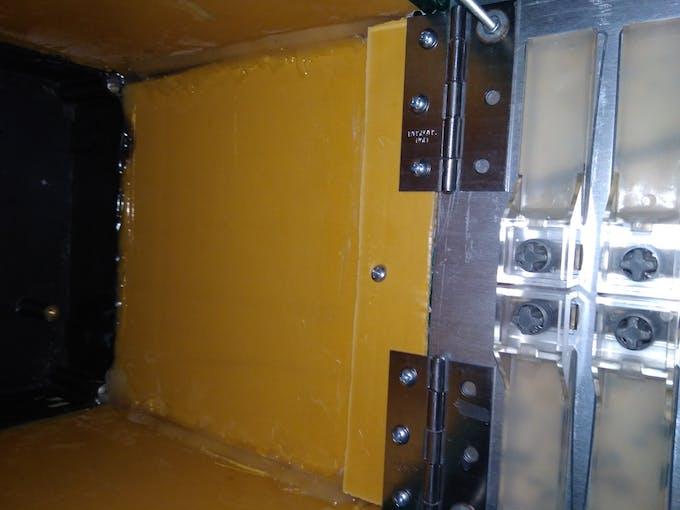 Hinge to attach front panel (door)