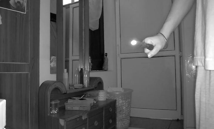 Wand tip glowing in night vision.