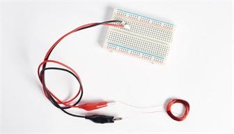 Attach alligator clips to the coil wire leads and insert into your breadboard.