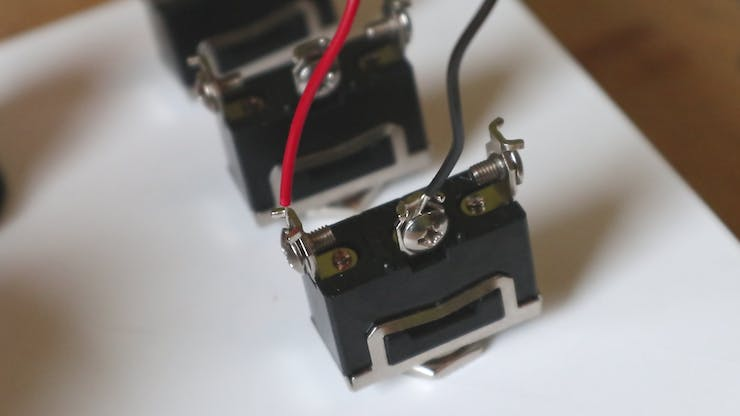 A toggle switch with an plus and minus