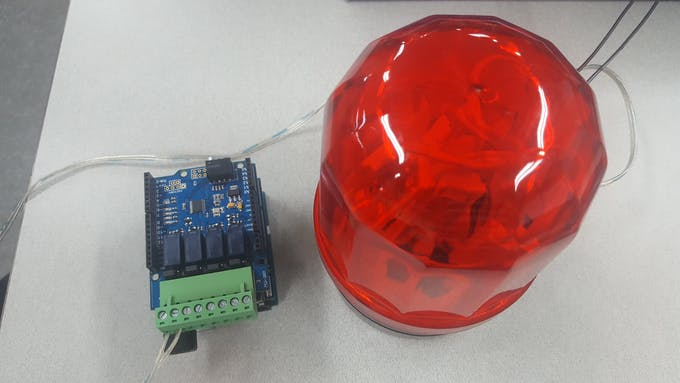 Arduino Uno + PHPoC Shield 2 + 4-port Relay Expansion Board, and a light bulb