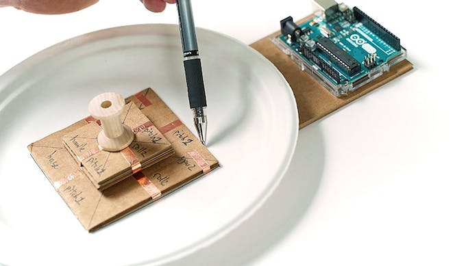 Place the joystick Base in the center of the plate and mark its location.