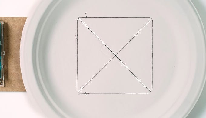 Find the center of the rectangle. Then mark the location of Yaw 1 and Yaw 2 (1 cm from top of Joystick Base).