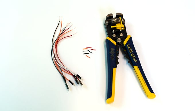Grab your M-to-M jumper wires. Cut off one end and remove about 1.5cm of insulation for each wire.