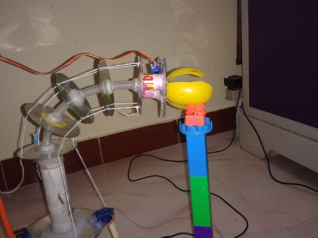 BT Mobile Ctrl Trunk Robotic Arm Using String