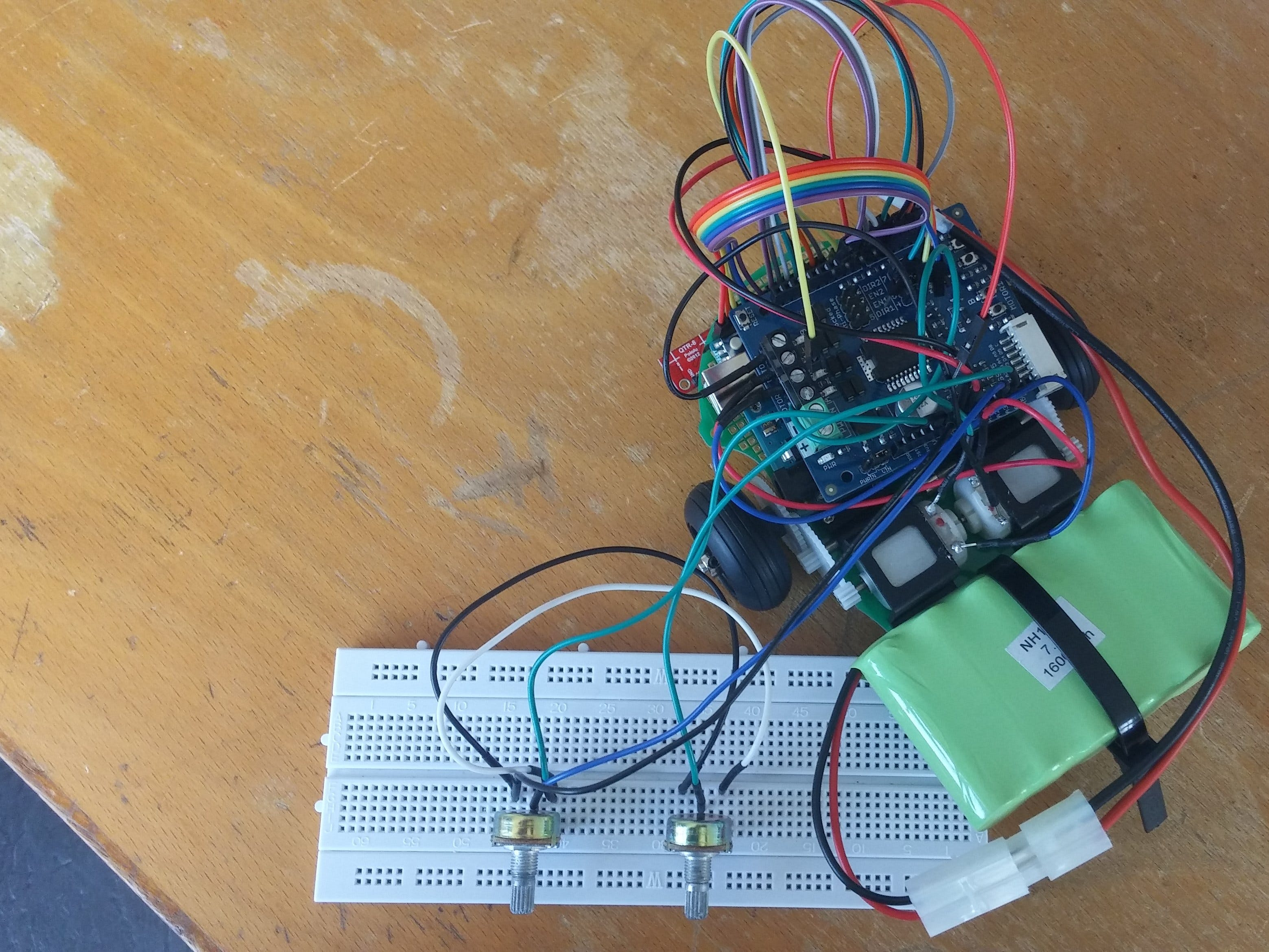 Controlling a low-cost robot with two potentiometers