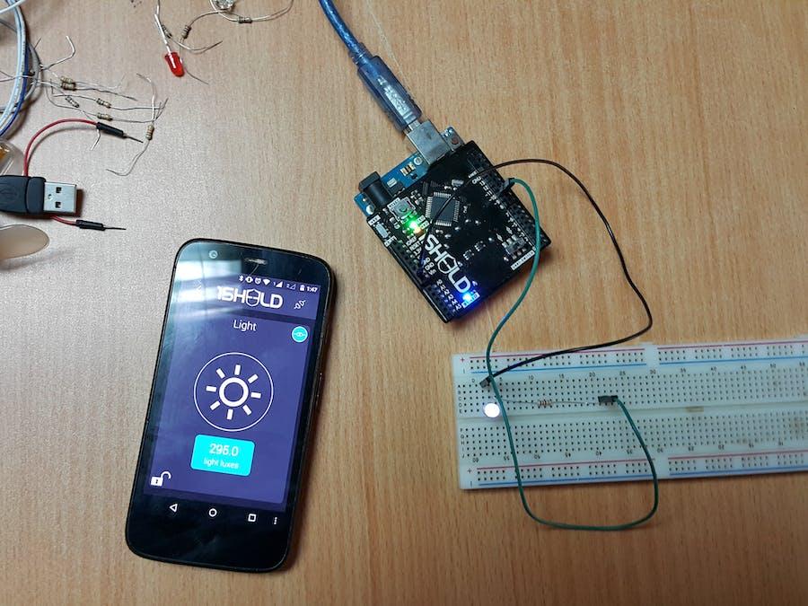 Controlling LED light intensity using smartphone light senso