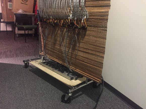 A wooden board helps hold the power supplies and keeps the curtain mobile!