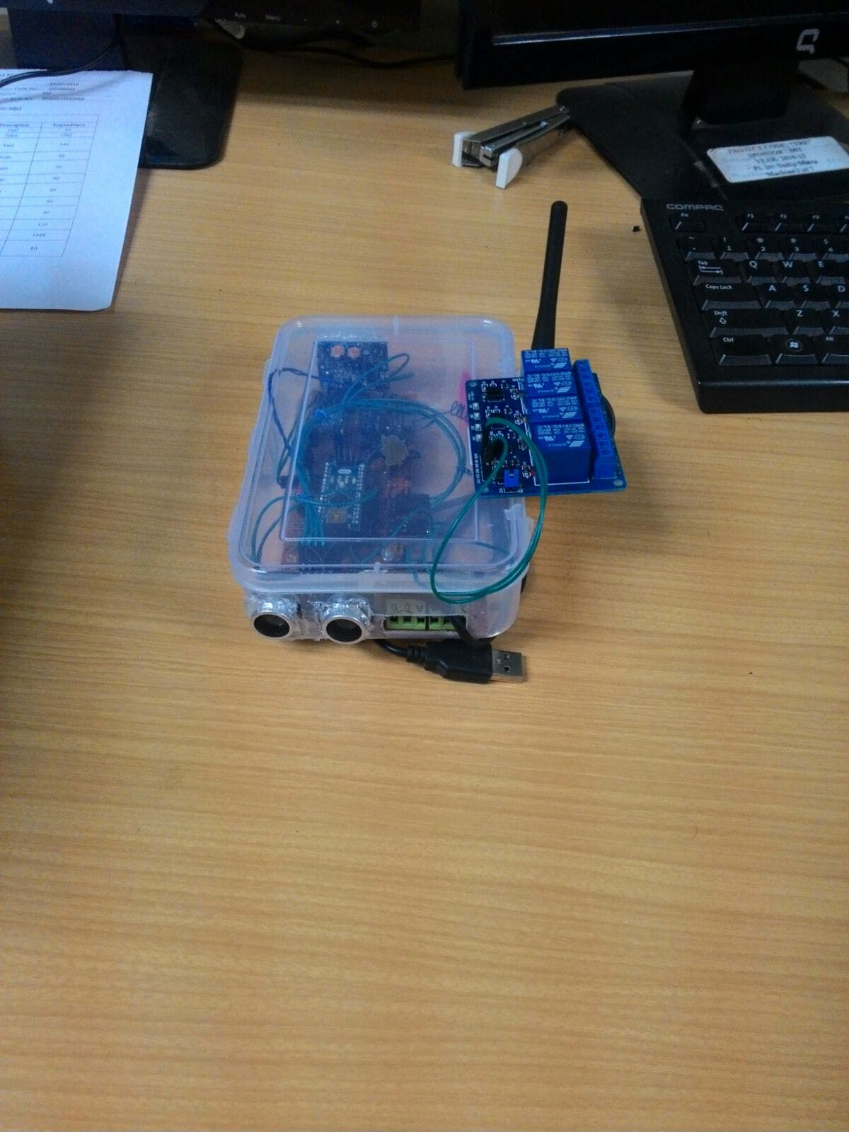 The ultrasonic distance sensor (at the bottom) doubles as a water level indicator