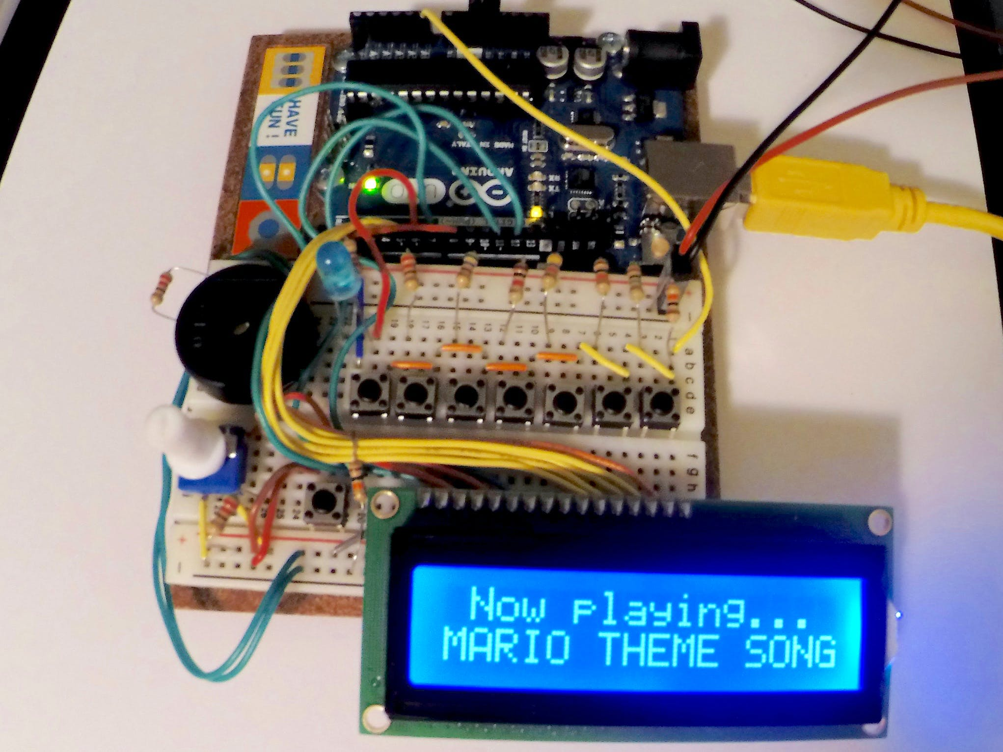 Push any piano key to play a song shown on the menu. The LCD will show the current song title.