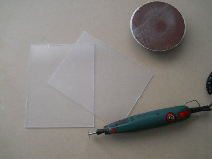 Use a rotary tool to cut the two plates.