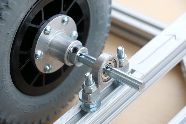 The aluminum base mount for the bearing, 375 Key Hub, Wheel, and set screw shaft collar