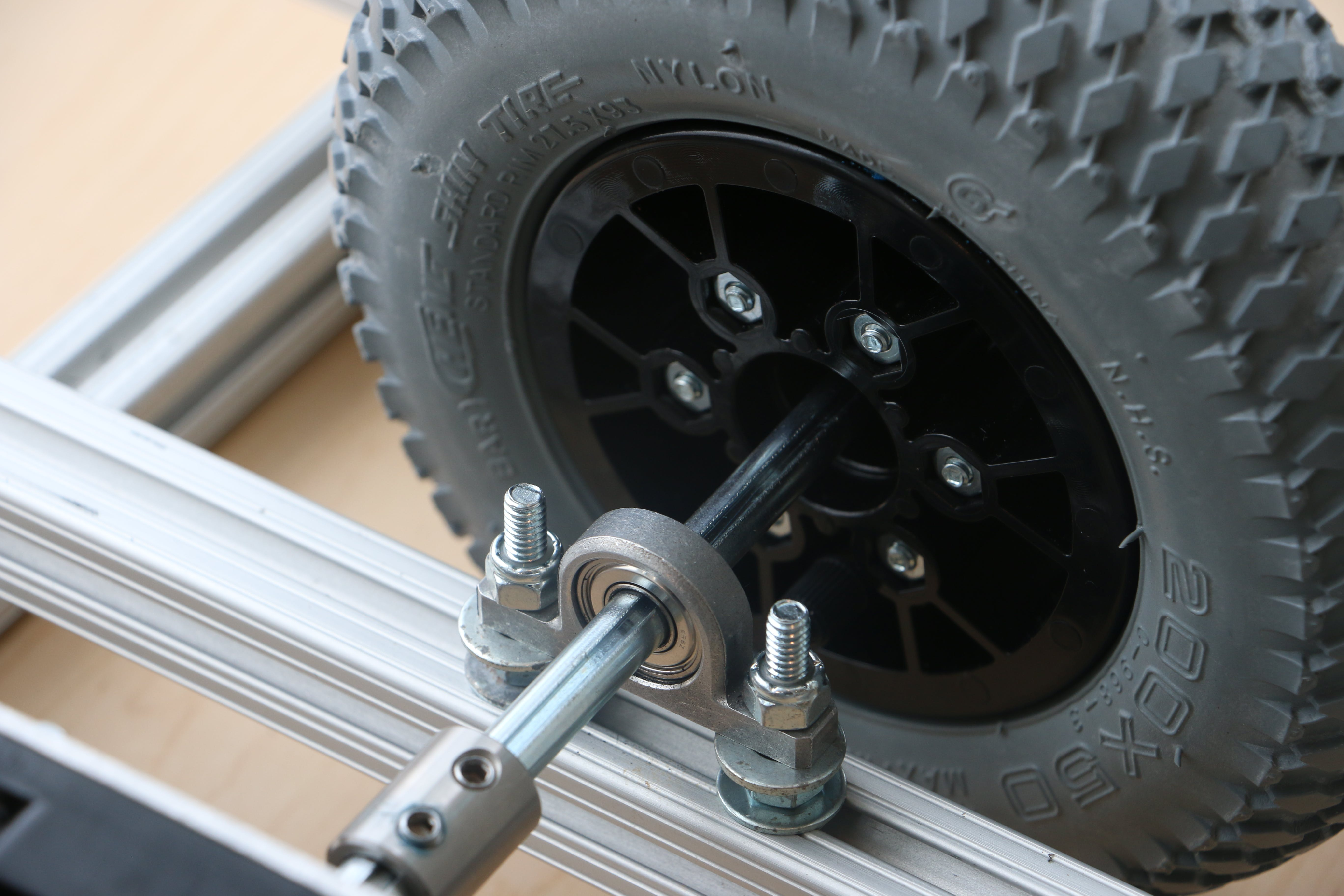 The aluminum base mount for the bearing + other side of the wheel, screws, and nuts.