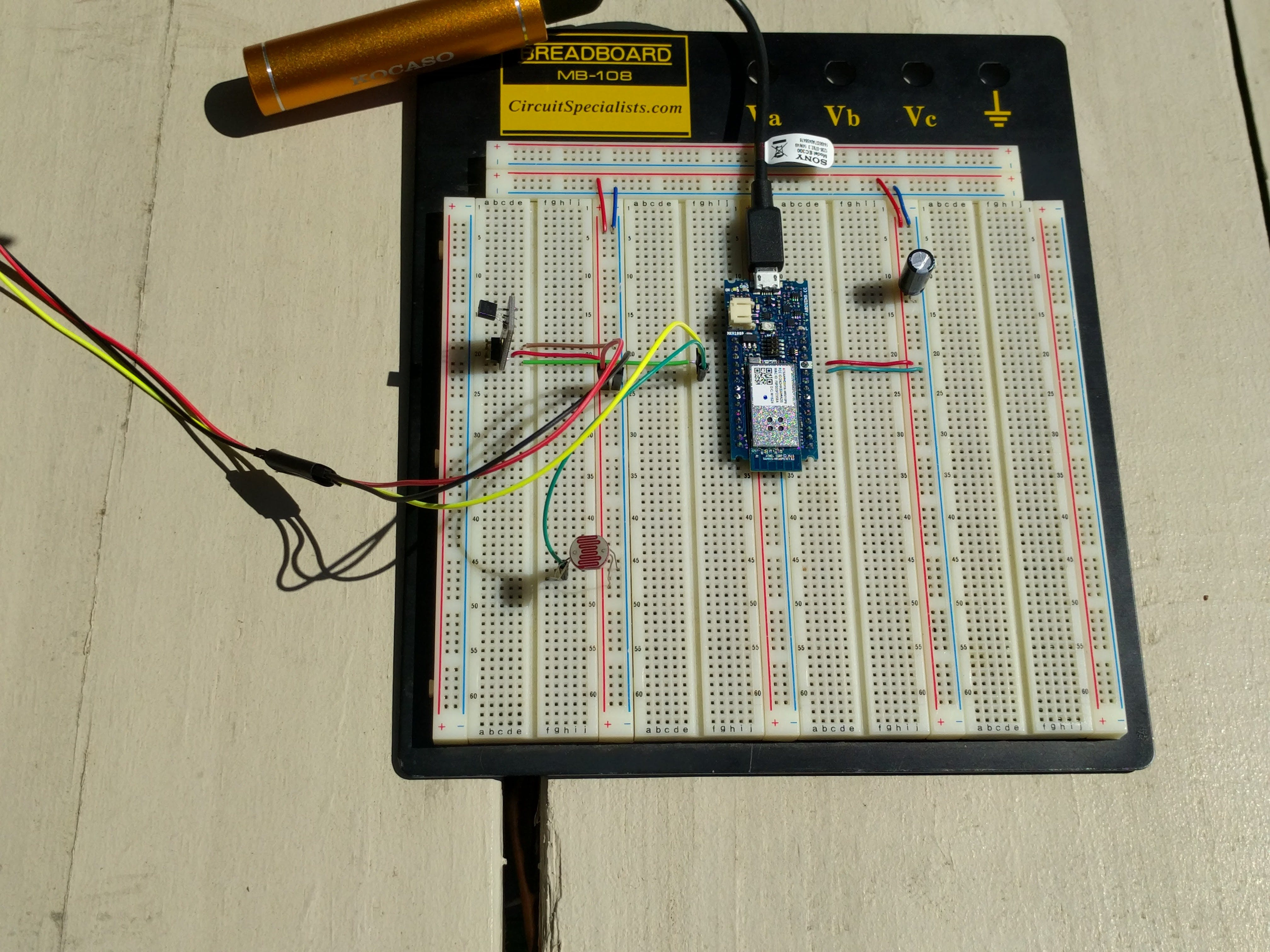 Circuit on breadboard, LM35 and photoresistor.
