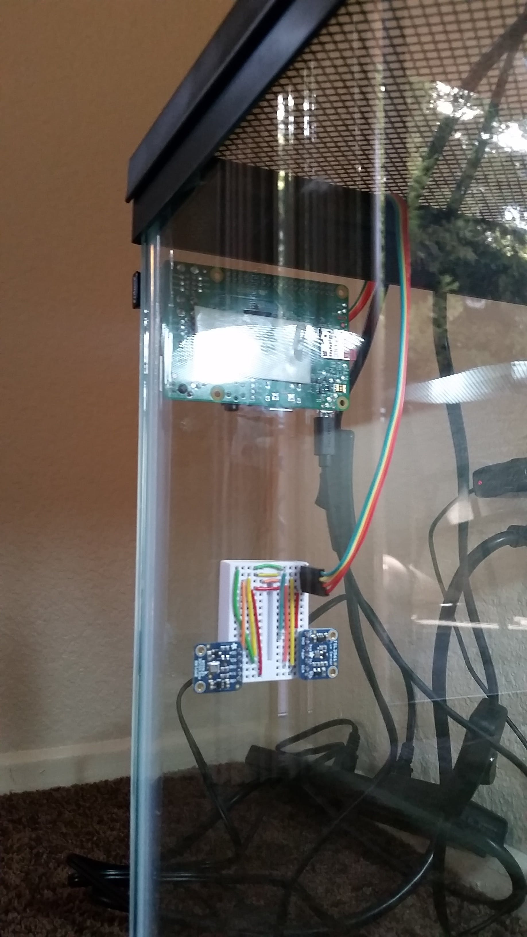 Side view of the two sensors (inside) and the Pi (outside)