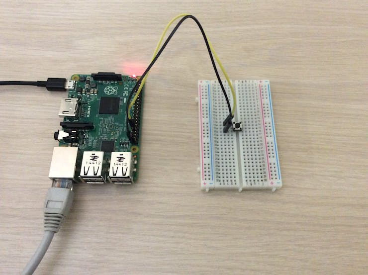 Windows 10 IOT Core on Raspberry Pi 2 using Windows.Devices.GPIO to listen for button presses.