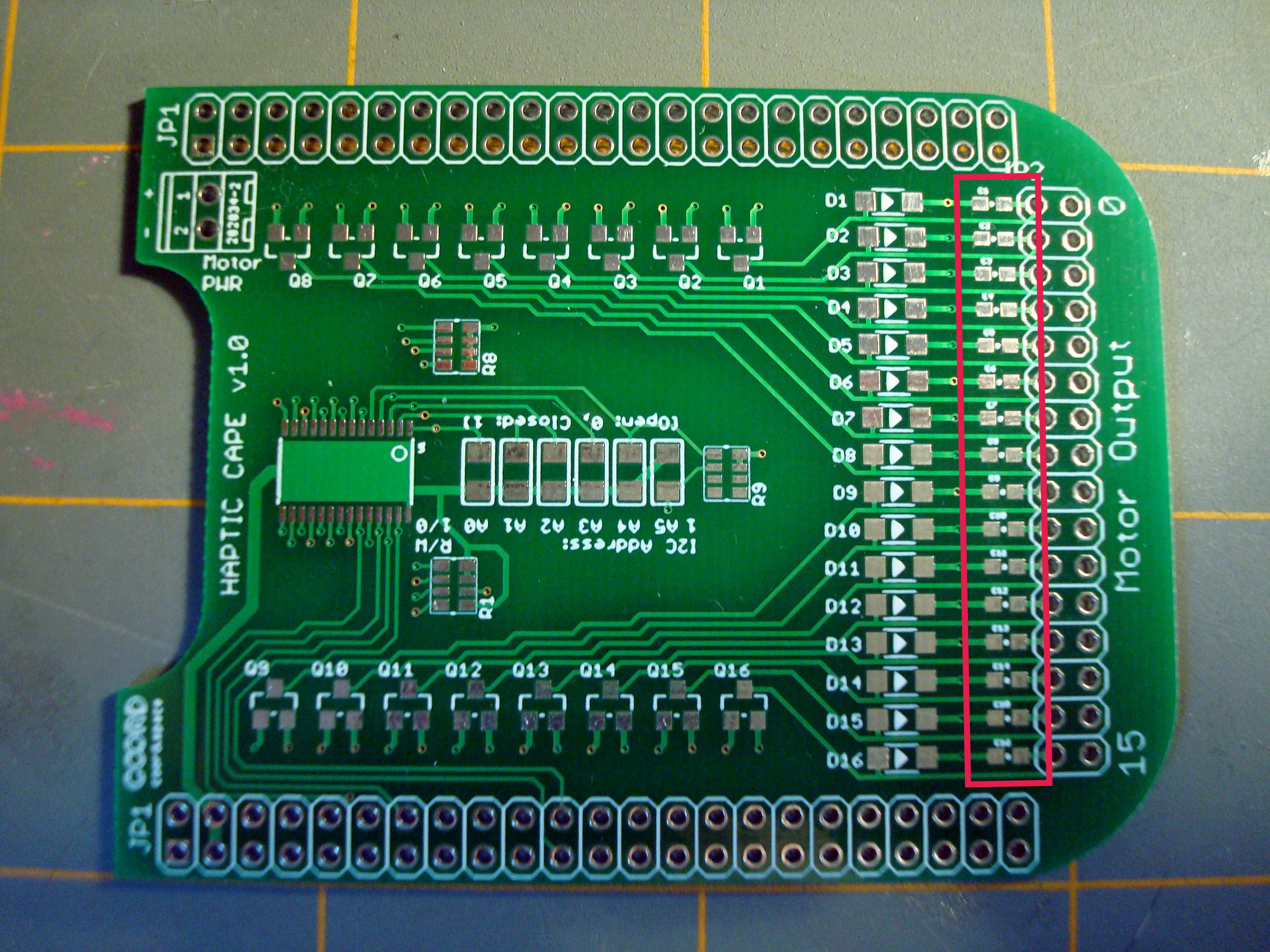 To start, identify the row of 0603 pads right next to the output header holes. These are for the CL10F104ZB8NNNC Capacitors. To follow the SparkFun SMD soldering guide, heat one row of these pads and drop a tiny bit of solder onto it, letting it flow out to cover the entire space.