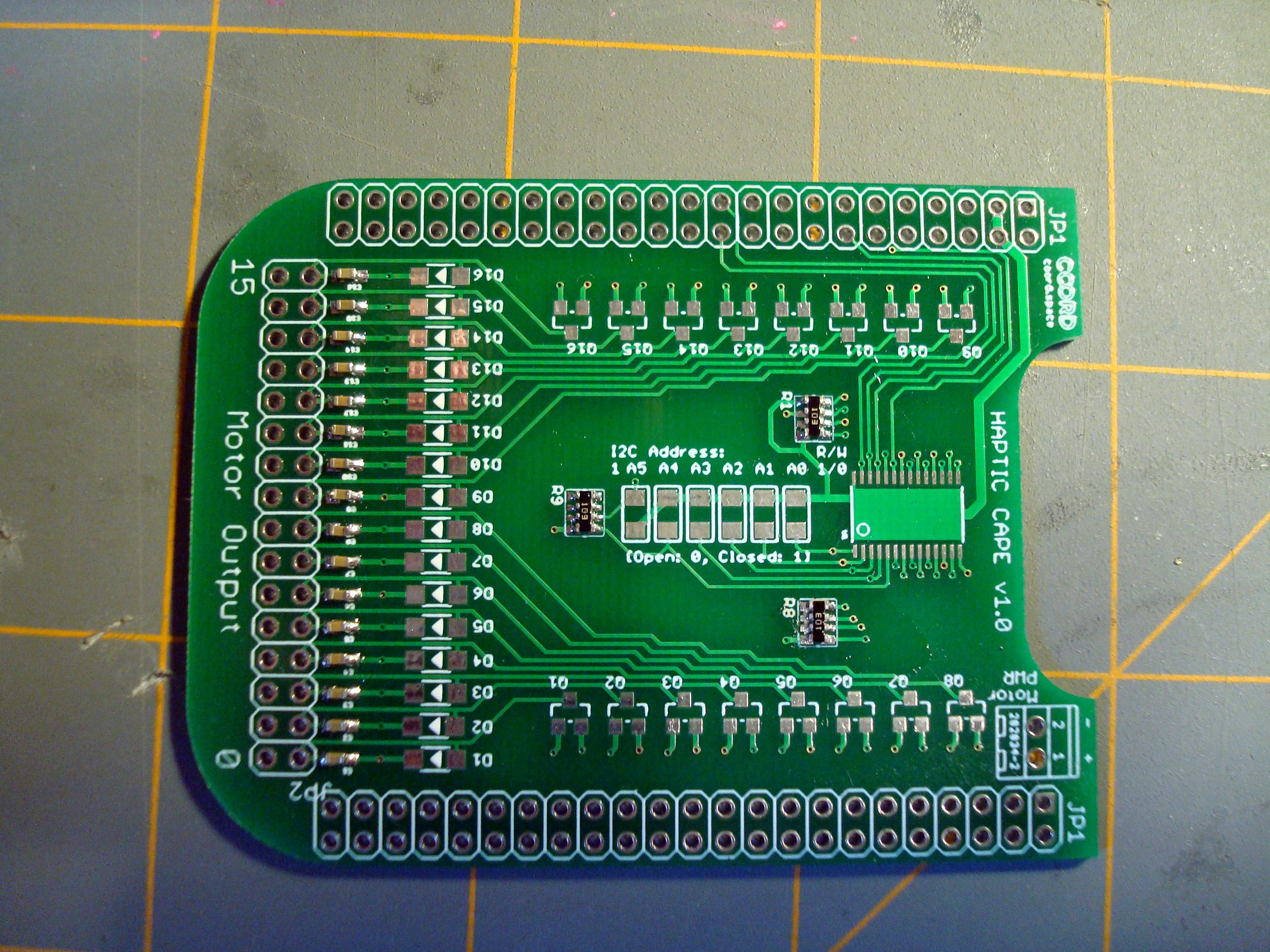 Now go around the part and flow small solder amounts onto each pad. Flux can be really helpful for this to prevent solder bridges. In the end your board should look similar to what's shown here.
