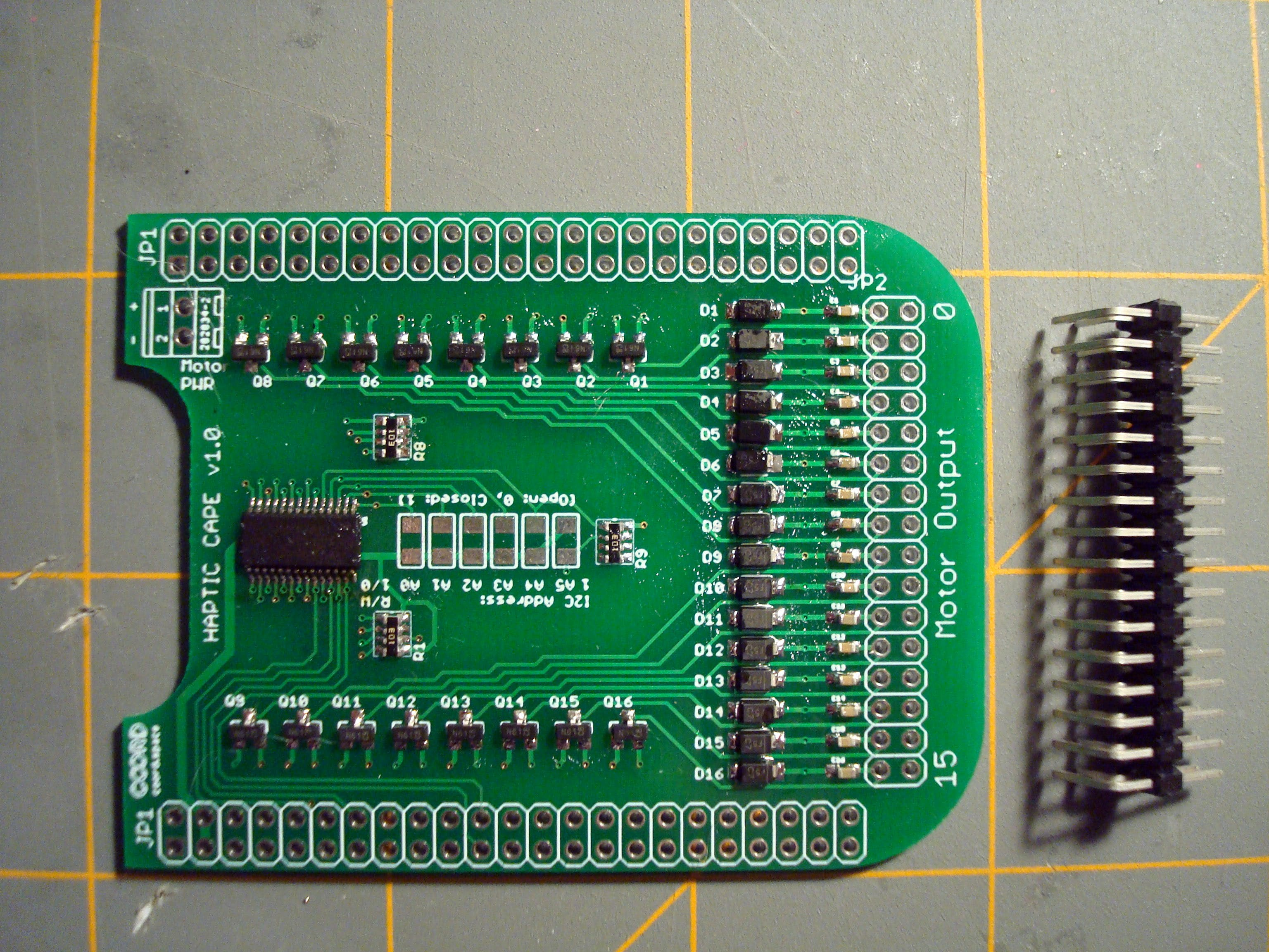 To attach our (max 16) tactors to the board, a 2x16 right-angle male header assembly is attached to the underside of the PCB.