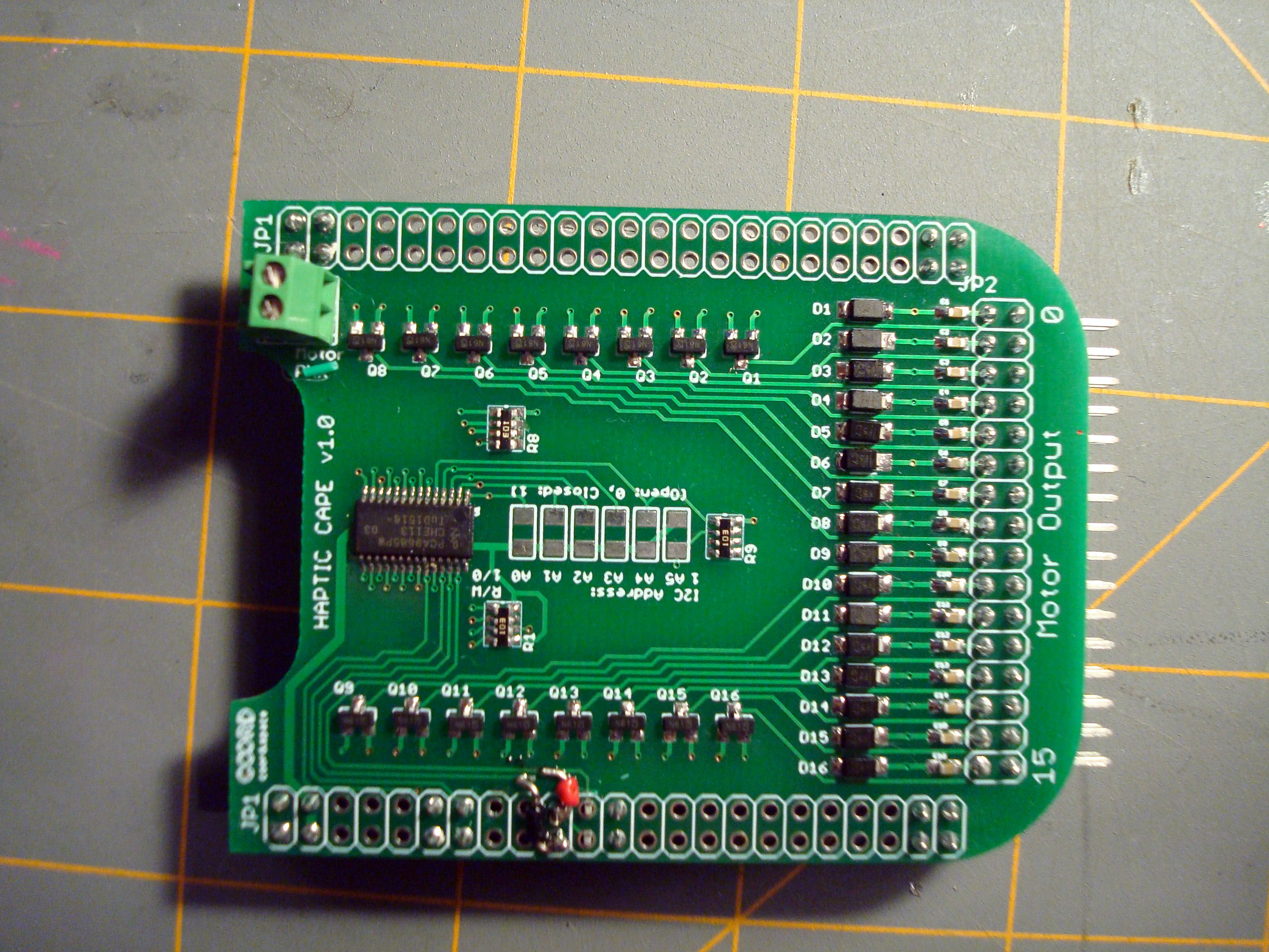 Bonus: Don't let anyone tell you that hardware is easy. For this early revision of the board, I made the mistake of putting the I2C lines on pins that (while shown as I2C2 pins in the docs) were not available for use. Since there wasn't enough time for another round of PCBs before the deadline, I had to do some quick rework. A little trace scraping and some tiny solid core wire later and it was working just fine. Luckily for you, the current version of the Haptic Cape has been updated with this fix along with a few smaller improvements!