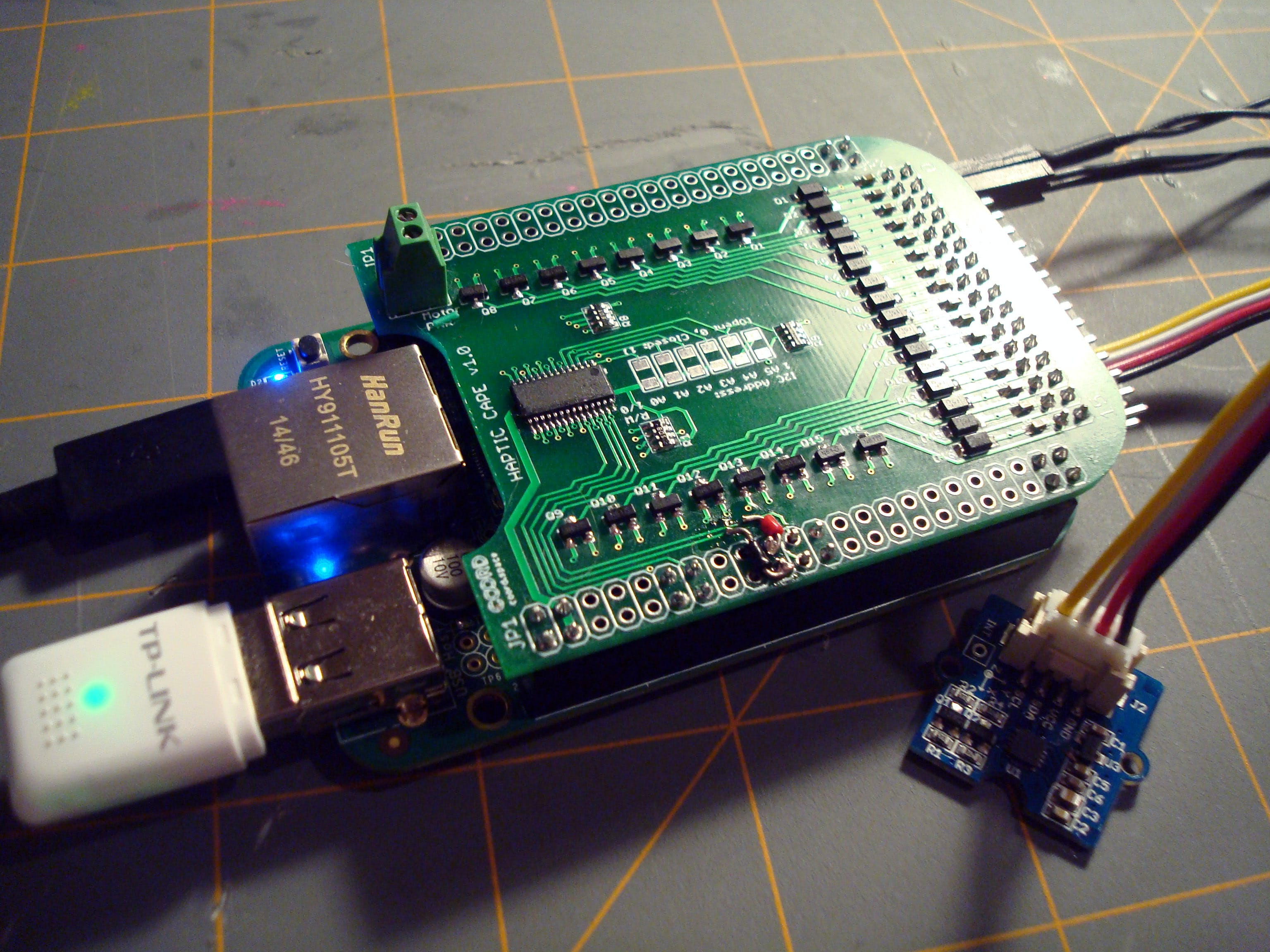 Here it is! The finished Haptic Cape plugged into a BeagleBone Green with a Seeed Grove Compass sensor. Don't worry about those little wires in the bottom middle, those were placed to overcome a trace routing error that has already been fixed in the bitbucket repository. Read on to learn more...