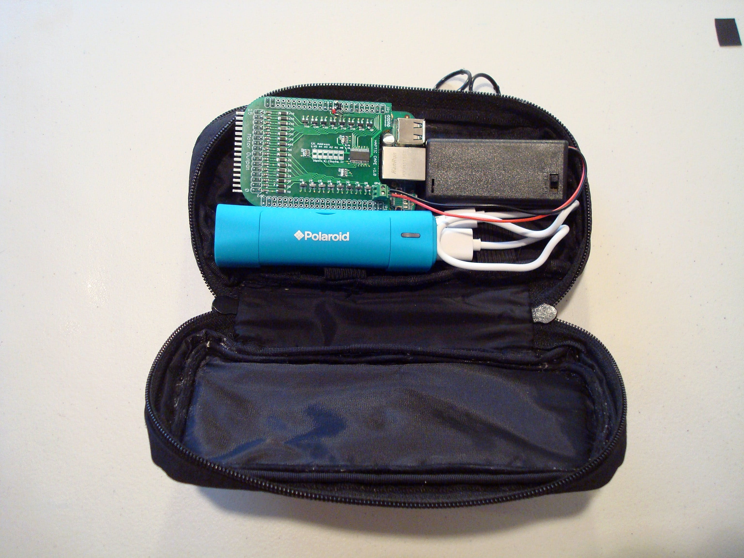 Since this is a wearable belt, a soft case for holding all the bits and pieces needed to run our equipment is vital. I've sourced a cheap case on Amazon in the project Component and Supplies list that will work just as well as the case I received as a promo freebie years back.