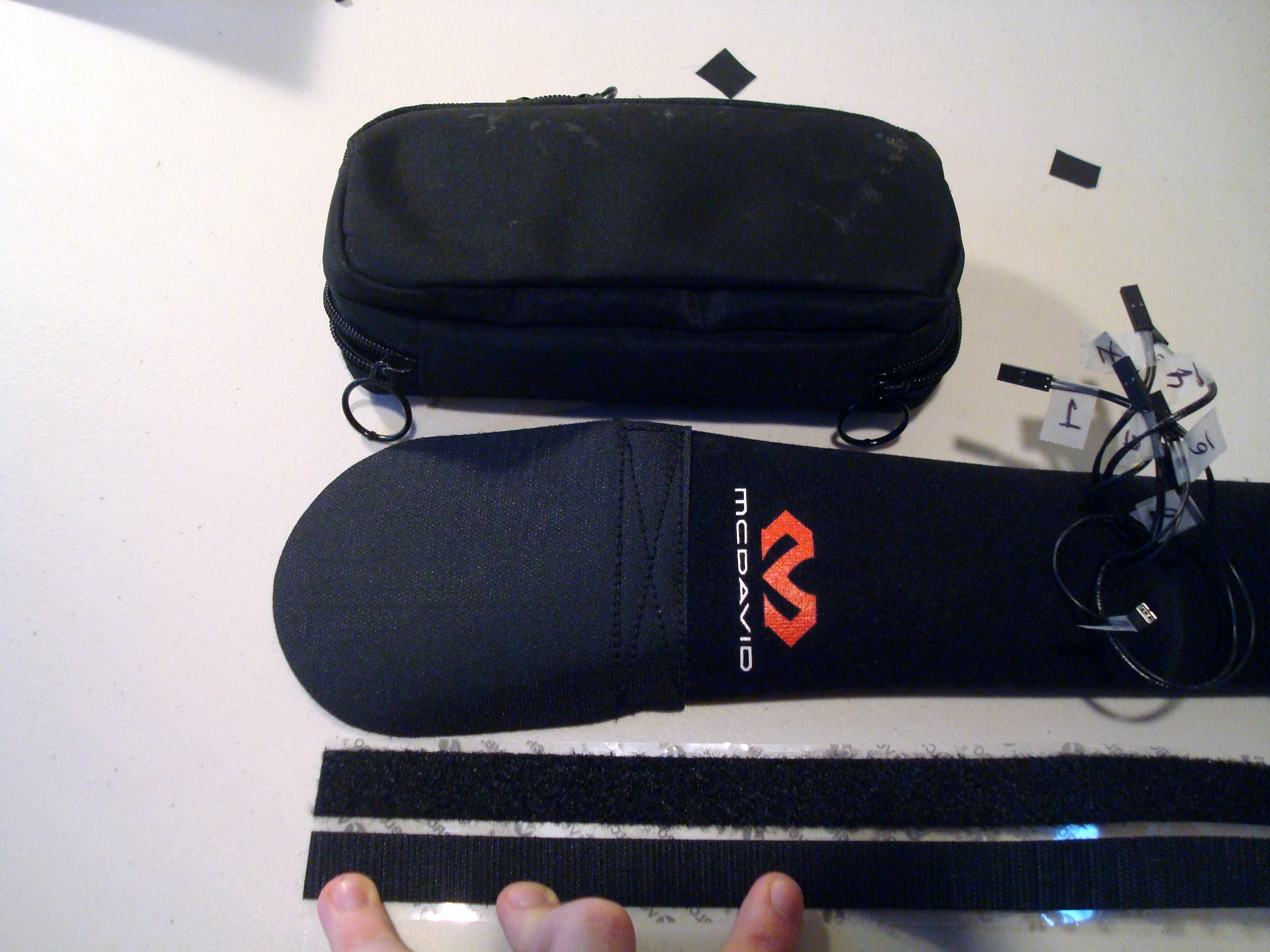 To attach the case that holds all the electronics, cut three more velcro strips about the length of the case.