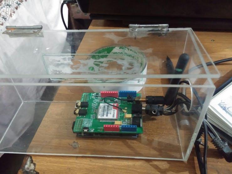 Fig 19: Arduino + GSM Shield inside the Transparent Plastic Box