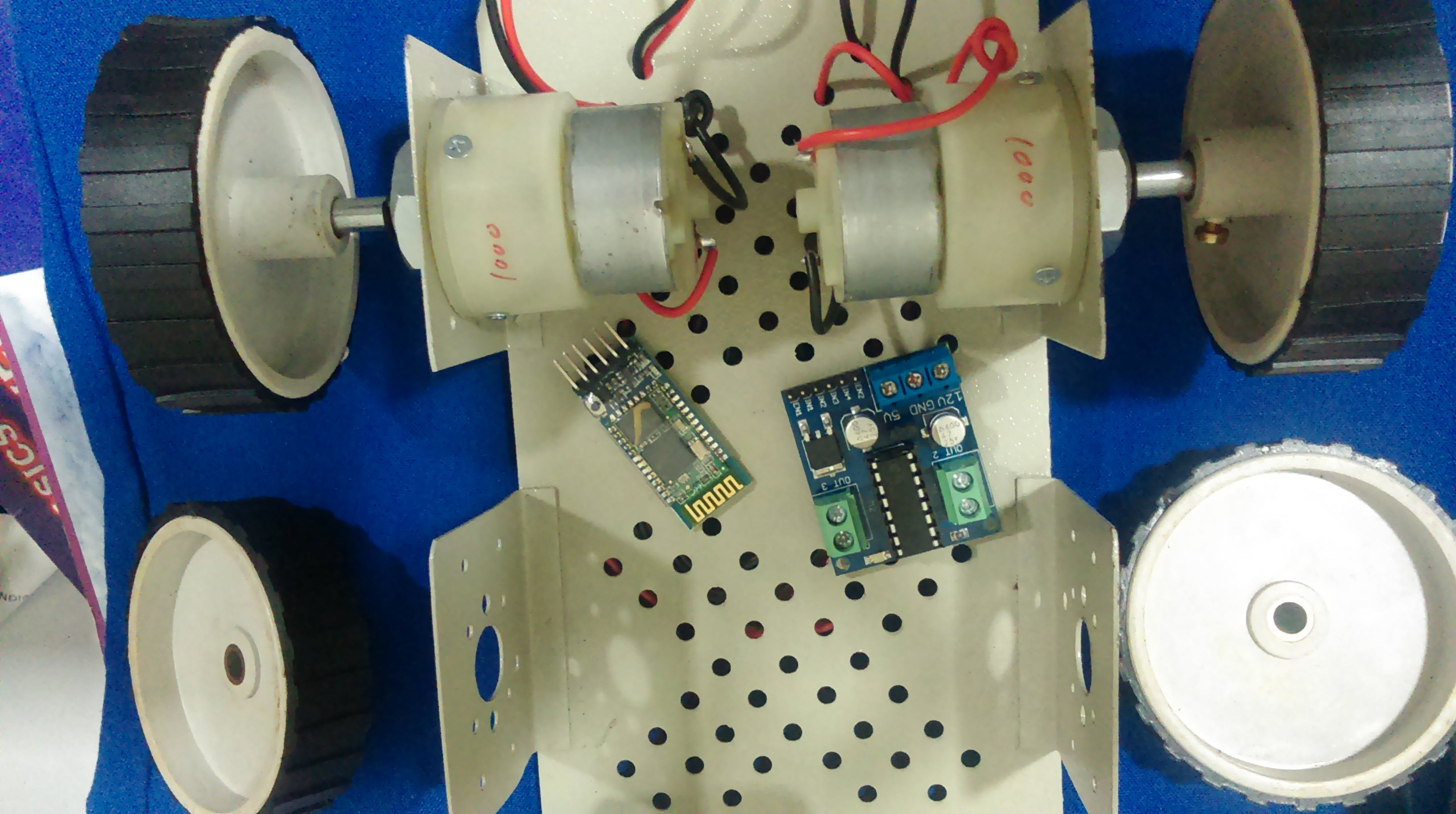 motordriver , dc motors, motor driver, bluetooth module, motor wheels , metallic chassis.