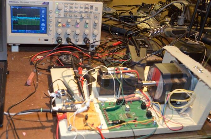 Shows battery, stepper motor, driver board, MKR1000, Oscilloscope