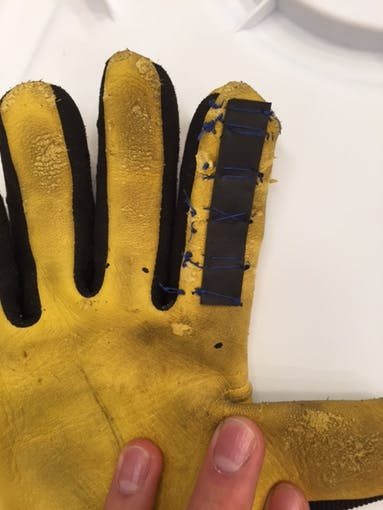 Heat shrink tubing re-sewn to the glove