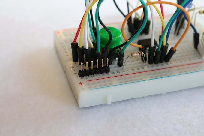 Six-pin header in the breadboard on aDHT Tiny.