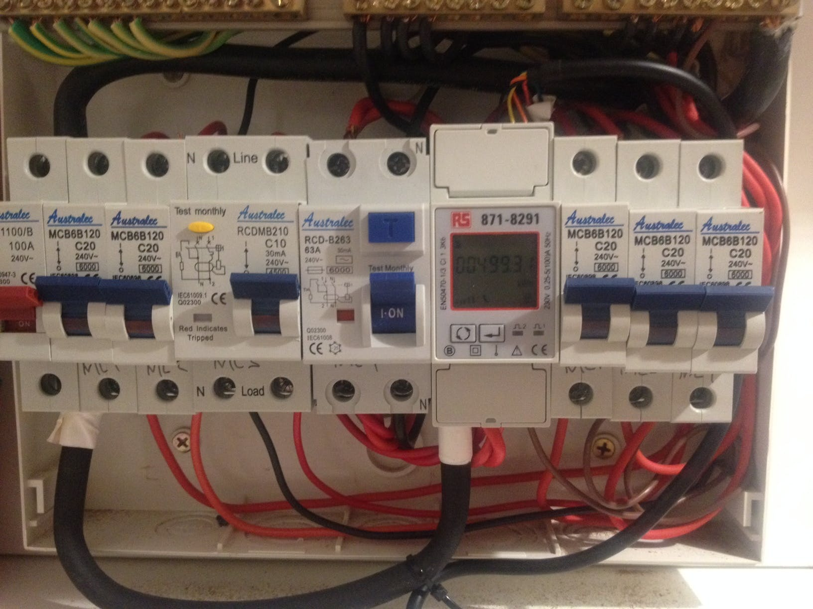 Energy Meter in Switchboard with RS485 connection on top.