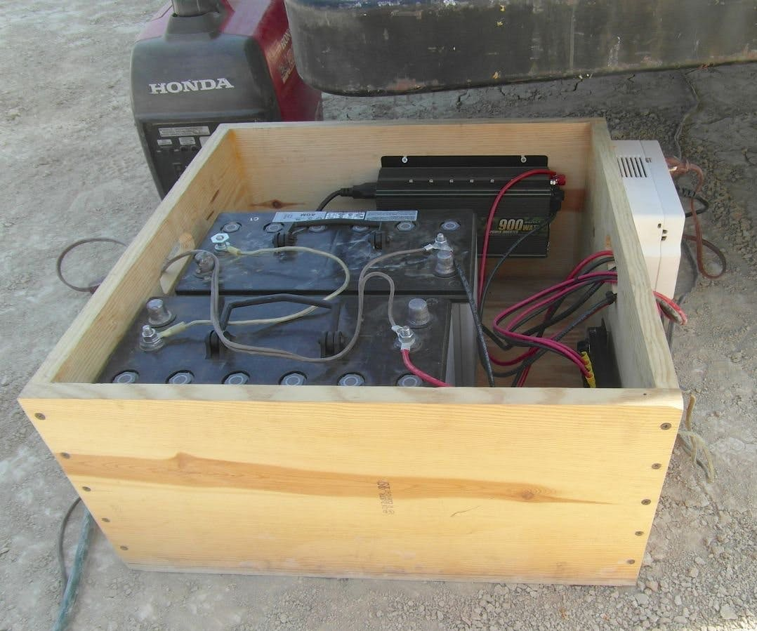 Burning Man mobile solar power unit with the rev1 controller (white box). The generator in the upper left corner serves as the 'utility power' (or wall plug)