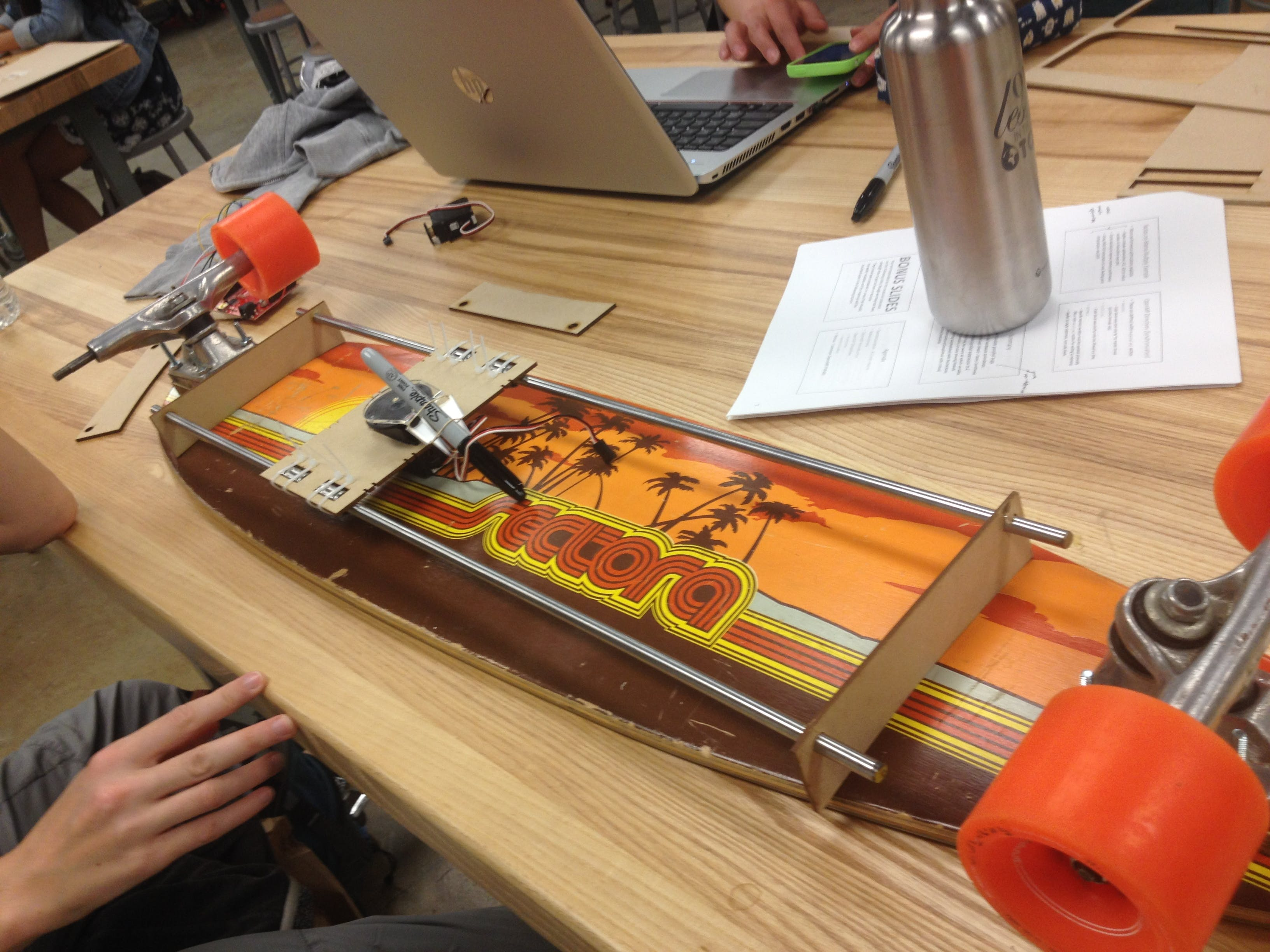 XY-plotter built using wood, acrylic bearings, steel rods, rubber bands, and servos