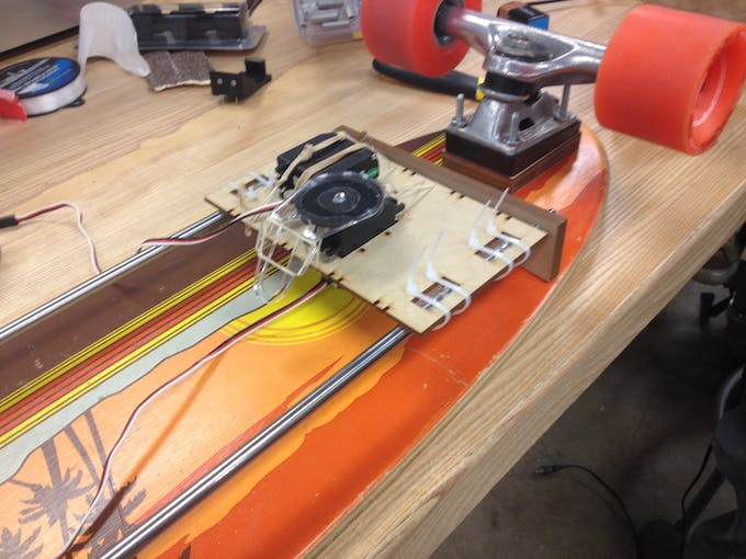 Temporary securing of servos using rubber bands