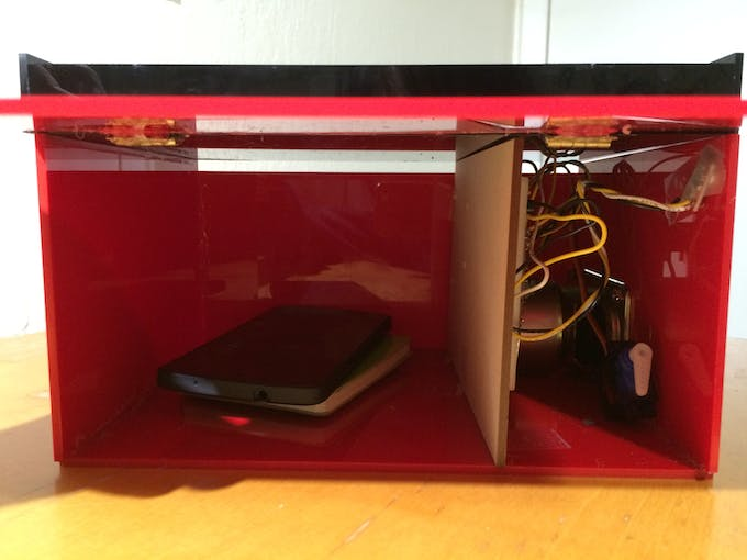Compartment to place phones and the electrical work.