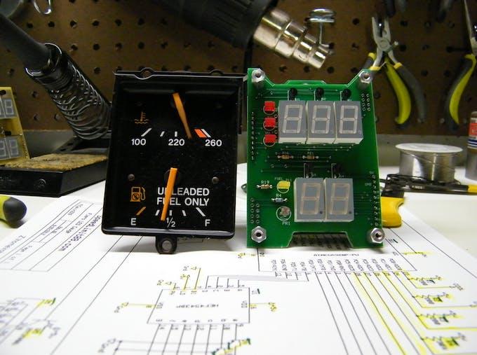 Original gauge from Pontiac Fiero next to the new display