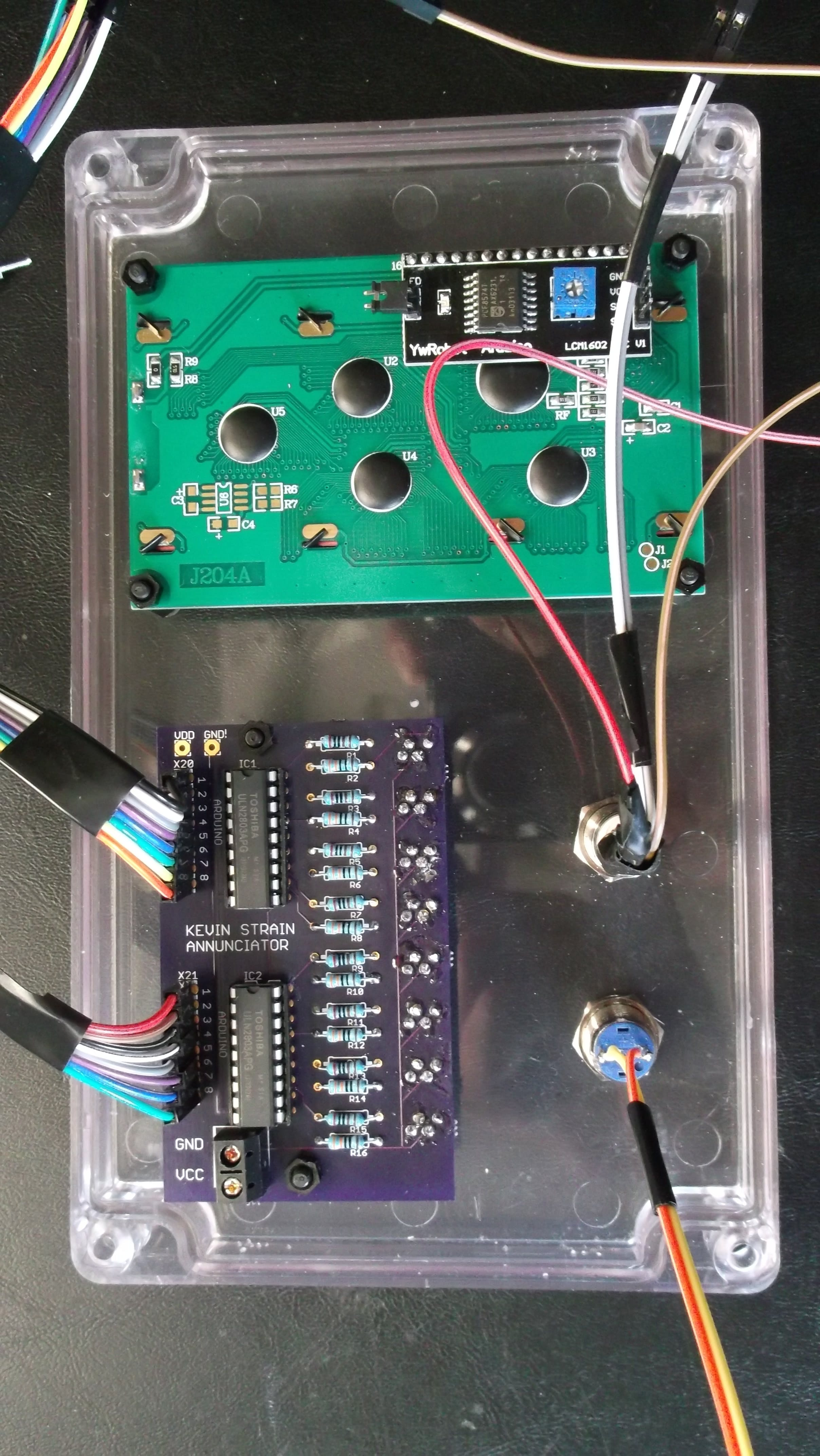 Front cover showing annunciator board, LCD display, reset and message enable pushbutton.