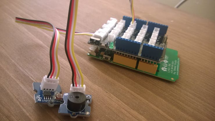 Light Sensor plugs into A0, Buzzer into D3