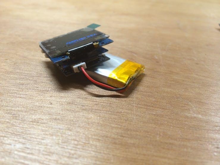 Top to bottom: TinyScreen, Accelerometer TinyShield, TinyDuino LiPo, LiPo Battery